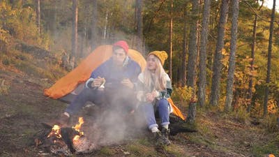 Camping Tent Camp in Nature Happy Caucasian Friends in Autumn at Nature Forest Hike