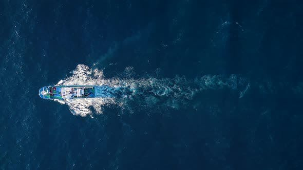 Thumbnail for Top View of a Fishing Boat Sailing in the Atlantic Ocean