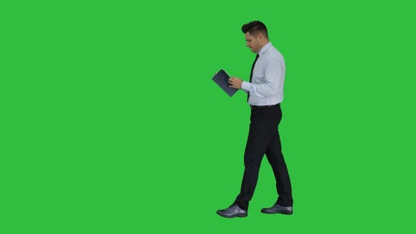 Thumbnail for Young confused man trying to read smart book misunderstanding