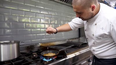 Male Cook in Restaurant Kitchen Squeezing a Lime