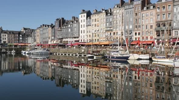 HONFLEUR, FRANCE - SEPTEMBER 2016 Northern  Normandy The Vieux Bassin port  by the day with colorful