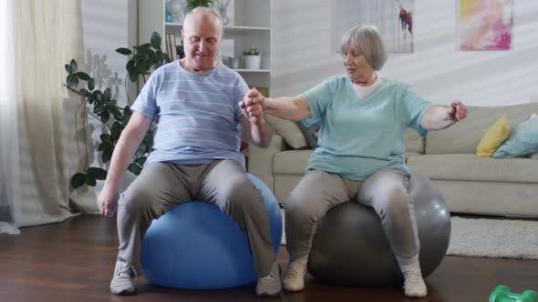 Senior Couple Exercising with Stability Balls
