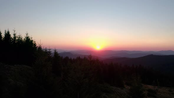Thumbnail for Aerial Drone View. Sunrise or Sunset in the Mountains, Flying Over the Trees in the Sun Wide View V8