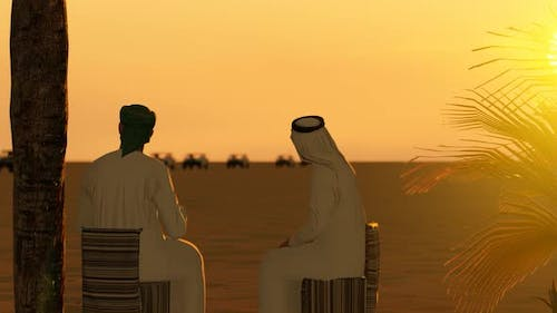 Two Arab Men Talking in the Desert and Sunset View