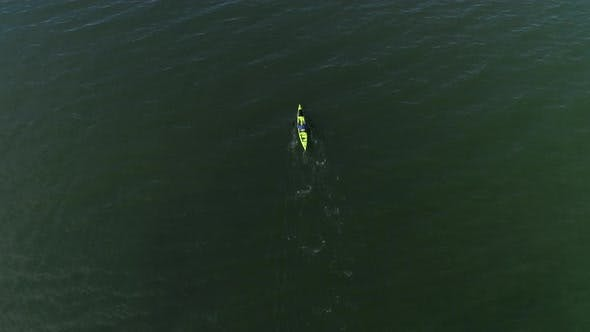 Thumbnail for Isolated Kayak Aerial Of Man Paddling Endless Ocean Slow Motion
