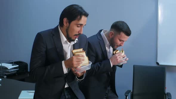 Thumbnail for Office Workers Have a Break From Work To Eat Second Breakfast