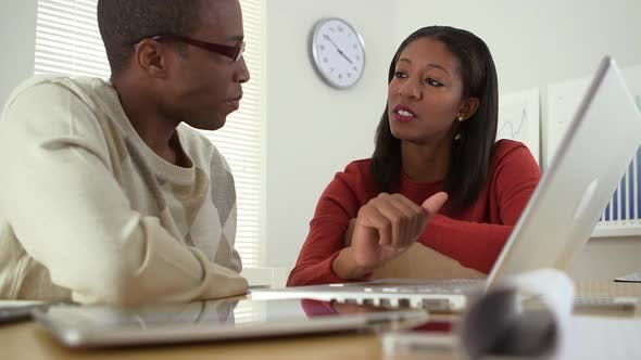 Thumbnail for Black business colleagues using laptop computer together