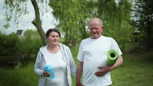 Healthy Lifestyle, Older Men and Women Couples Take Hold on Hands After Morning Workout Outdoors
