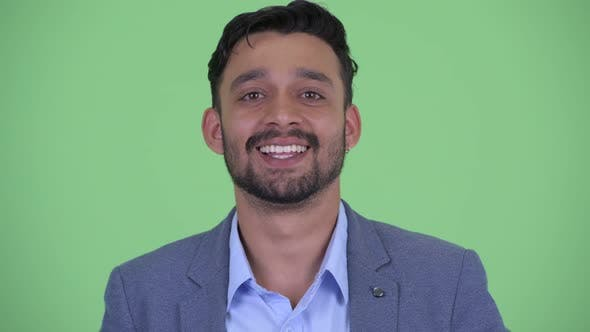 Thumbnail for Face of Happy Young Bearded Persian Businessman Smiling