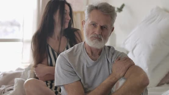 Thumbnail for Close-up of Handsome Grey-haired Caucasian Man and Brunette Blurred Senior Woman Looking at Camera