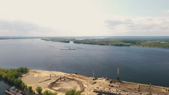 Thumbnail for Construction River Port, View From a Quadcopter. Construction Cranes and Equipment Stands on the