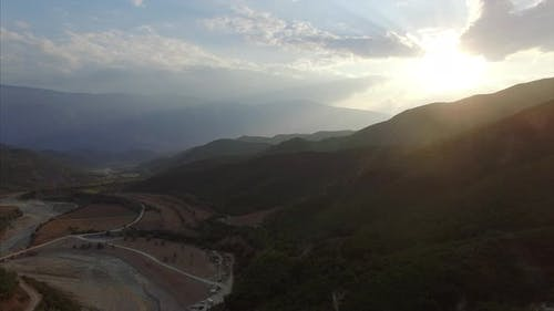 Sun shining on mountains in Albania