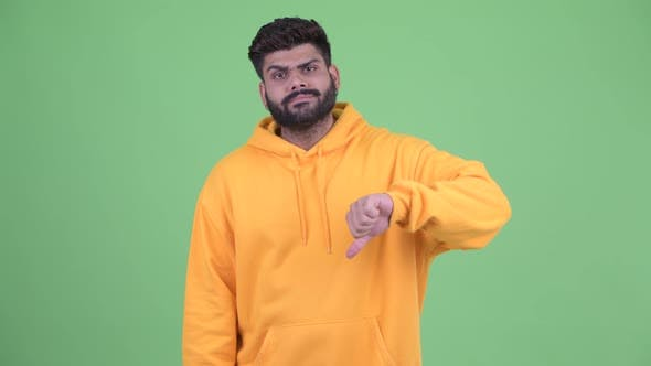 Thumbnail for Angry Young Overweight Bearded Indian Man Giving Thumbs Down