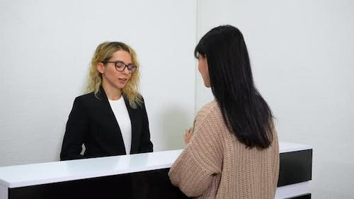 Receptionist Welcoming Visitor of Beauty Salon