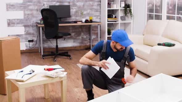 Thumbnail for Confused Male Worker While Assembling a Shelf