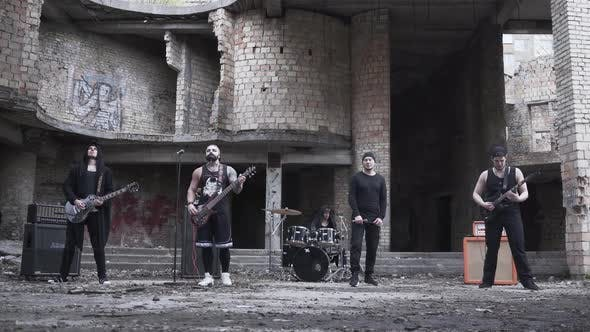 Thumbnail for Rock Band Playing Music in the Abandoned Building. Brutal Men Starred in a Music Video