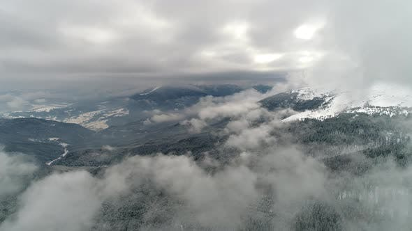 Cover Image for Beautiful Mountain Day, Fly Over Cloudy Winter Land