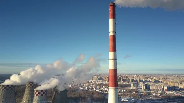 Thumbnail for Aerial Motion Past Chimney and Cooling Towers Against City