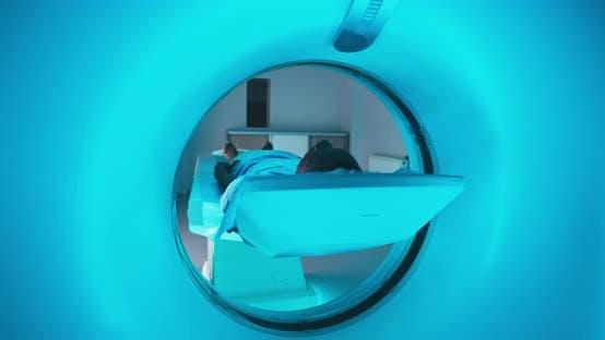 Black Patient Entering Modern CT Machine