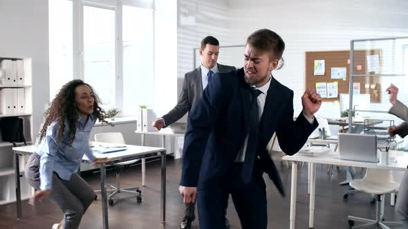 Thumbnail for Excited Business Team Dancing in the Office