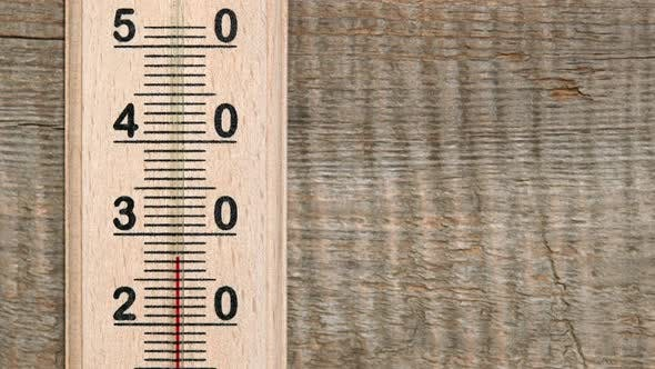 Thumbnail for Increasing Temperature on Wooden Thermometer with Red Scale