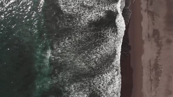 Top View of the Giant Waves Foaming and Splashing in the Ocean Slow Motion Video