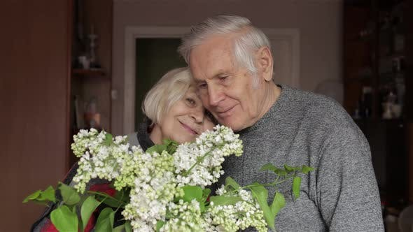 Thumbnail for Portrait of a Happy Grandfather and Grandmother. Grandpa Kissing Gandma
