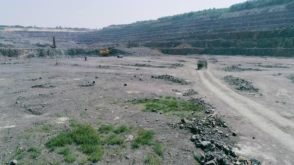 Thumbnail for Mining Dump Trucks in Large Granite Open Pit Mine. Slow Motion