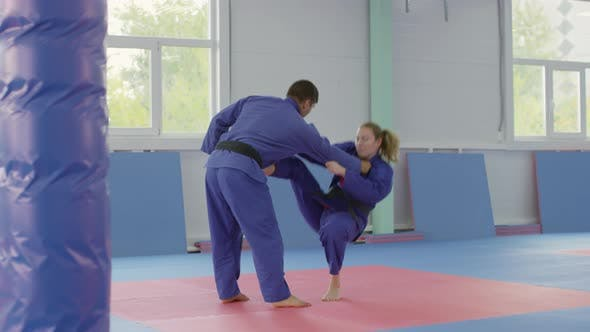 Thumbnail for Young Caucasian Man and Woman Practicing Jiu-Jitsu