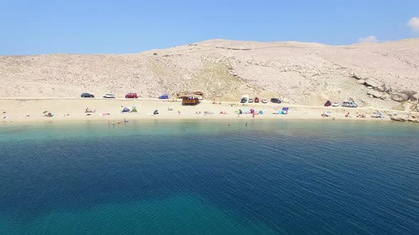 Thumbnail for Aerial view of tourists on isolated beach of Pag island, Croatia