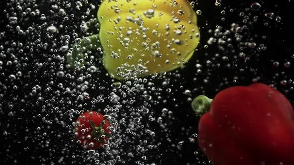Thumbnail for Vegetables Cherry Tomatoes and Red Yellow Bell Peppers Falling Into Water Black Background