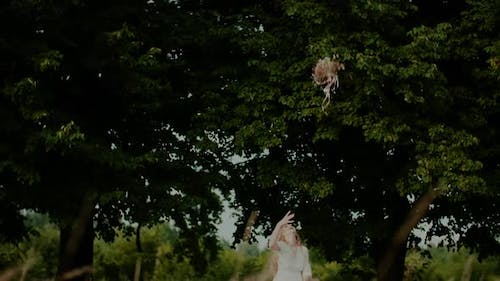 Carefree Woman Tosses Bouquet Up