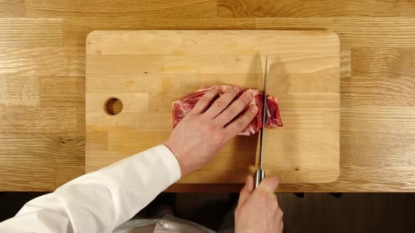 Thumbnail for Cook Takes Knife And Cuts Pork Into Slices And Then Into Pieces