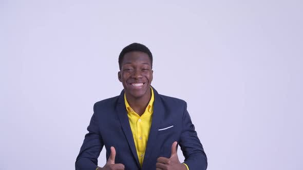 Young Happy African Businessman Looking Excited While Giving Thumbs Up