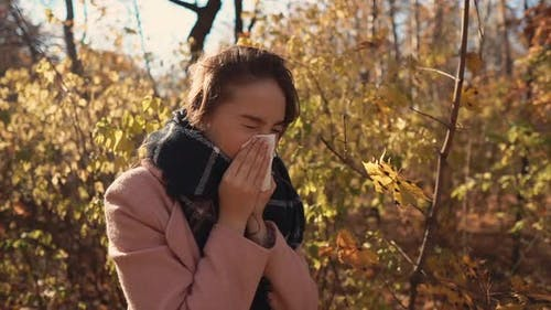 Allergic Girl in a Forest in Autumn.