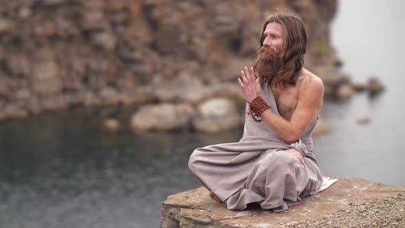 Thumbnail for Yogi on the Rock Near the River