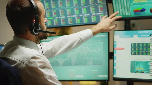 Thumbnail for Broker with Headphones Checking the Stock Market