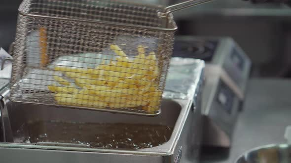 Cooked French Fries in a Restaurant Kitchen