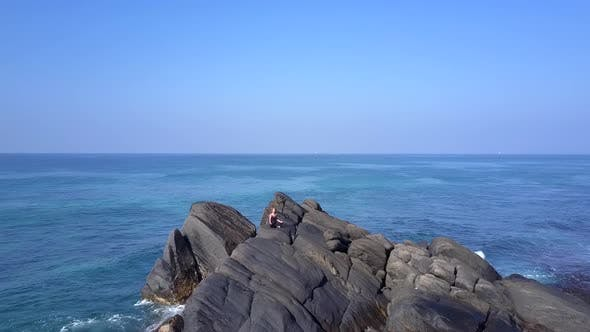 Thumbnail for Girl Silhouette Practices Yoga on Cliff Surrounded By Ocean