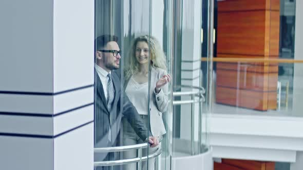 Thumbnail for Businesspeople Riding Glass Elevator