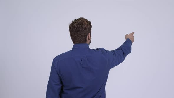 Thumbnail for Rear View of Young Indian Businessman Pointing Finger