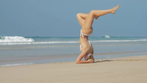 Thumbnail for Lady Stands in Sirsasana Headstand Pose and Straightens Legs