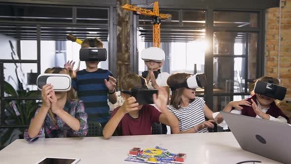 Thumbnail for Happy Young Pupils of Elementary School Using Virtual Reality