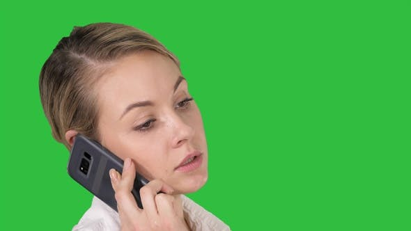 Thumbnail for Woman with blonde hair talking on cellphone on a Green