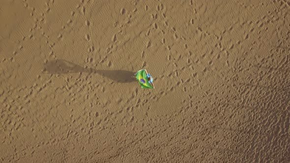 Thumbnail for Woman on the Sand with Brazilian Flag, Aerial Shot