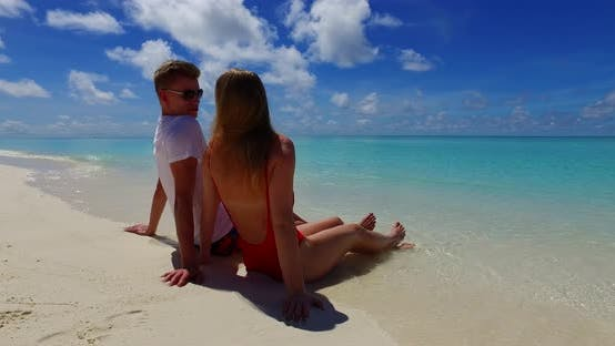 Thumbnail for Beautiful lady and man on romantic honeymoon spend quality time on beach on white sand 4K background