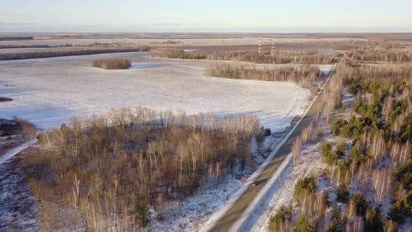Thumbnail for Car On Winter Road Near Village