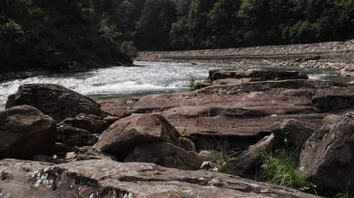 Landscape of Mountain River with Big Boulders on Bank