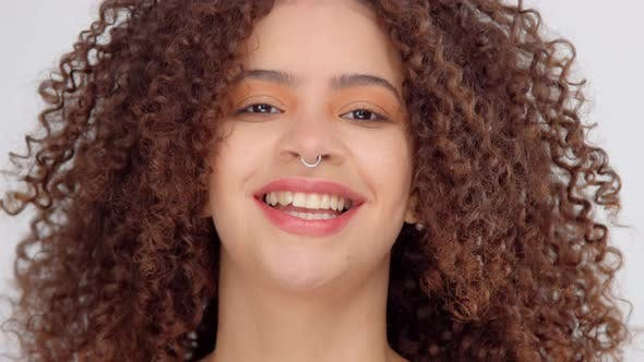 Thumbnail for Mixed Race Black Woman with Freckles and Curly Hair in Studio on White Poses To a Camera