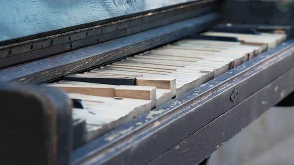 Thumbnail for Old Rusty Piano Outdoors Close Up. Overview of a Keyboard of an Old Piano. Antique Music Instrument